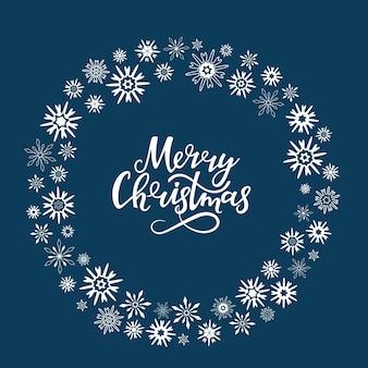 Frohe weihnachten handgezeichnete schrift. runder rahmen aus schneeflocken. grußkarte für die neujahrsfeiertage