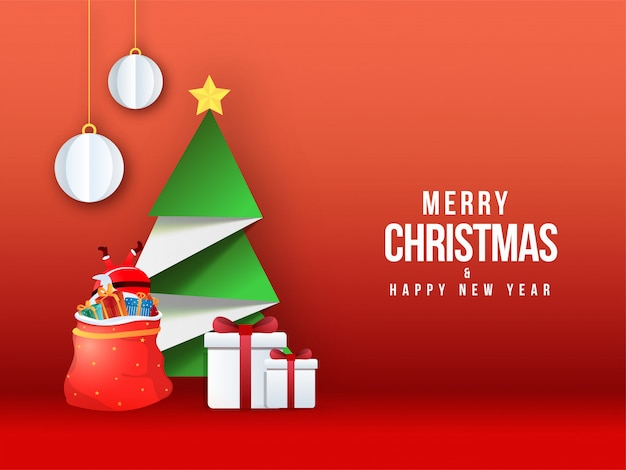 Frohe weihnachten & happy new year grußkarte mit kreativen papier weihnachtsbaum, santa fallen in geschenktüte und kugeln hängen auf rot.