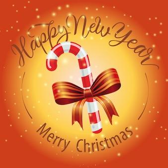 Frohe weihnachten, happy new year-schriftzug mit zuckerstange
