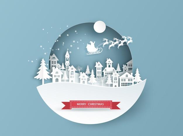 Frohe weihnachten-karte in winterlandschaft mit häusern und gebäude und santa claus am himmel