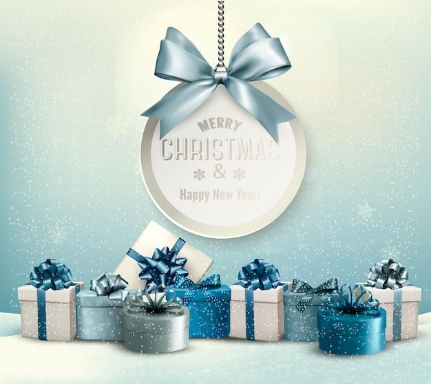 Frohe weihnachten karte mit einem band und geschenkboxen.