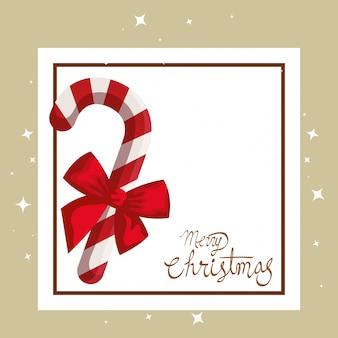 Frohe weihnachten-karte mit zuckerrohr und quadratischen rahmen