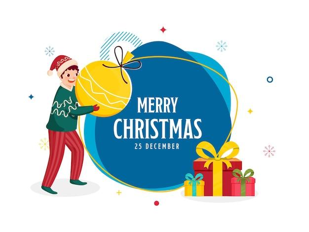 Frohe weihnachten-konzept mit fröhlichen jungen mit flitter, geschenkboxen und blauem und weißem hintergrund.
