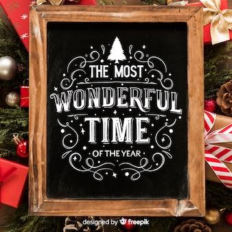 Frohe weihnachten-konzept mit schriftzug