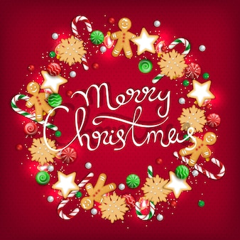 Frohe weihnachten kranz aus süßigkeiten, keksen, lutschern, süßigkeiten, zuckerstangen, lichtern lebkuchenmann