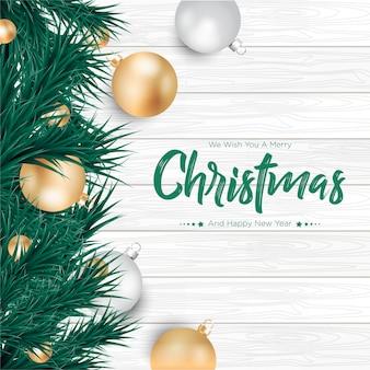 Frohe weihnachten mit gold- und silberballhintergrund