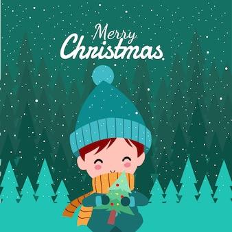 Frohe weihnachten mit netter kawaii hand gezeichnetem jungen-tragendem winter-kostüm und dem halten von grünen blättern mit lächelnder und lustiger gesichts-karikatur-vektor-charakter-illustration