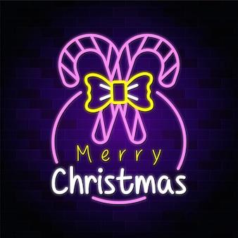 Frohe weihnachten neon design mit zuckerstangen premium vektor