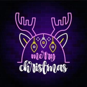 Frohe weihnachten neontext mit weihnachtshirsch - leuchtreklame banner und hintergrund