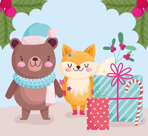 Frohe weihnachten, niedlicher bär und fuchs mit geschenken und zuckerstangenkarikaturillustration