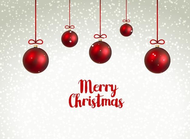 Frohe weihnachten rote kugeln. weihnachtsdekoration mit luxuskugeln. feiertagswinterfeier.