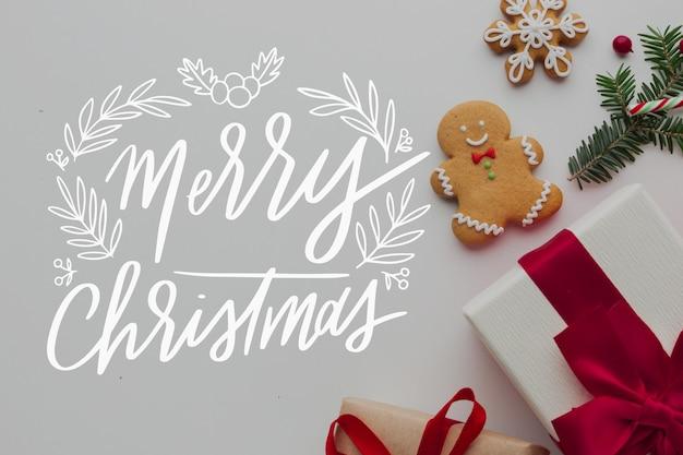Frohe weihnachten-schriftzug auf foto mit lebkuchen