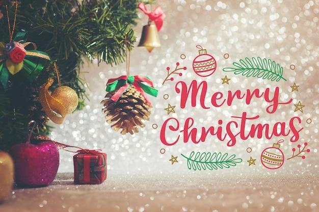Frohe weihnachten schriftzug auf weihnachtsfoto