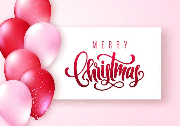 Frohe weihnachten schriftzug. elegante grußkarte mit realistischen glänzenden fliegenden luftballons