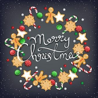 Frohe weihnachten schriftzug. kranz aus süßigkeiten, keks, keks, süßigkeiten, zuckerstange, lebkuchenmann
