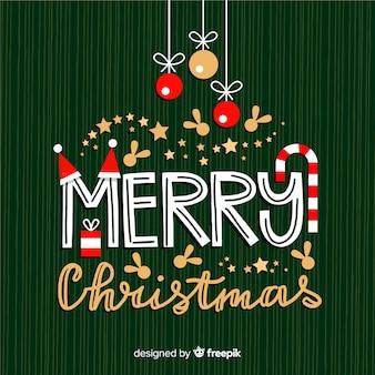 Frohe weihnachten-schriftzug mit dekorationen