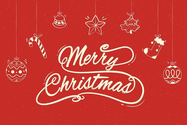 Frohe weihnachten-schriftzug mit hängenden weihnachtsschmuck