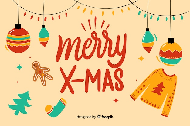 Frohe weihnachten-schriftzug mit kugeln und pullover