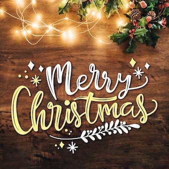 Frohe weihnachten-schriftzug mit lichtern