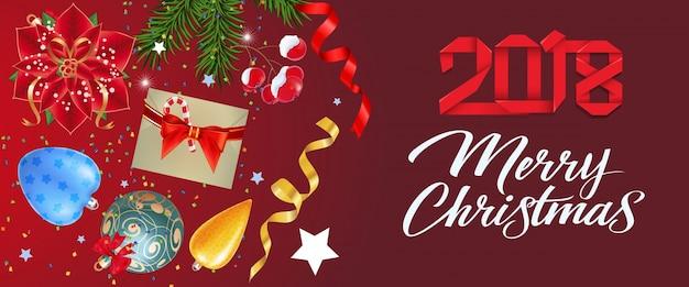 Frohe weihnachten schriftzug mit ornamenten
