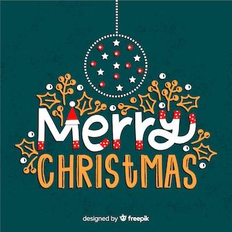 Frohe weihnachten-schriftzug mit ornamenten