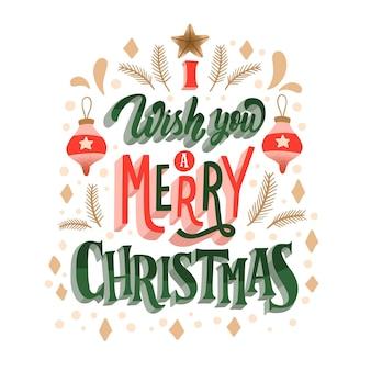 Frohe weihnachten schriftzug mit schneekugeln