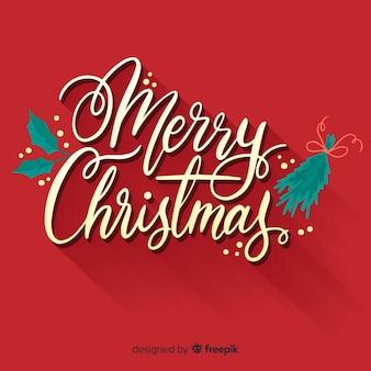 Frohe weihnachten-schriftzug mit vorabend dekoration