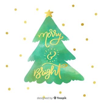 Frohe weihnachten-schriftzug mit weihnachtsbaum