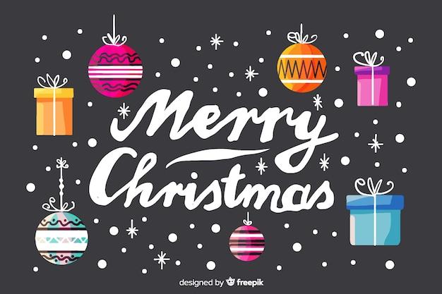 Frohe weihnachten-schriftzug mit weihnachtsdekoration