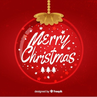 Frohe weihnachten-schriftzug mit weihnachtskugel