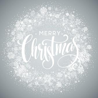 Frohe weihnachten-schriftzug mit weißen schneeflocken auf grauem hintergrund mit farbverlauf