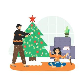 Frohe weihnachten szene. glückliches paar, das weihnachtsbaum verziert und spaß zu hause hat