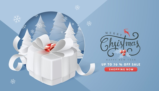 Frohe weihnachten und frohes neues jahr verkauf banner hintergrund mit geschenkbox papier kunst und handwerk stil.