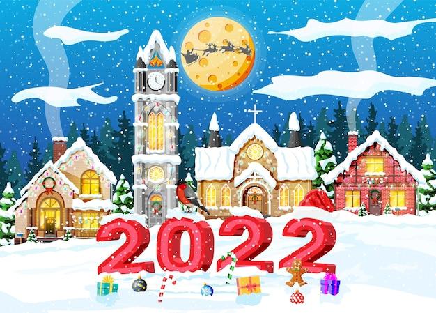 Frohe weihnachten und neujahr weihnachtsgrußkarte mit 2022 fetten buchstaben. weihnachtsmann-hut, geschenkbox, candycane, glaskugel und lebkuchenmann. gebäude der kirchenkapelle. flache vektorillustration