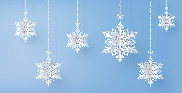 Frohe weihnachten und wintersaison mit papierschnitt-schneeflocke