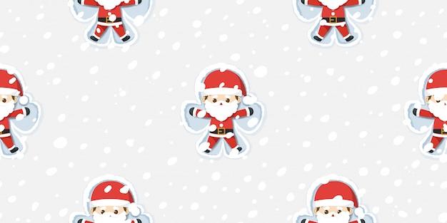 Frohe weihnachten, weihnachtsmann, der schneeengelmuster macht.