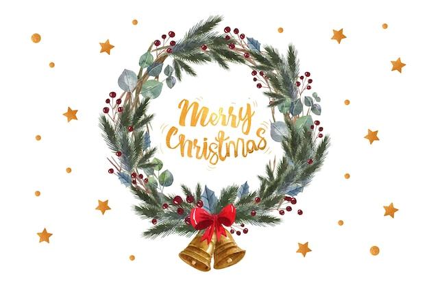 Frohe weihnachten zitat in einem kiefer blätter kranz