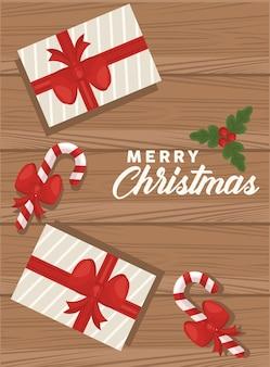 Frohe weihnachtsbeschriftung mit geschenken und stöcken im hölzernen hintergrund
