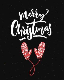 Frohe weihnachtskarte auf schwarzem hintergrund mit kalligraphie und roten handschuhen.