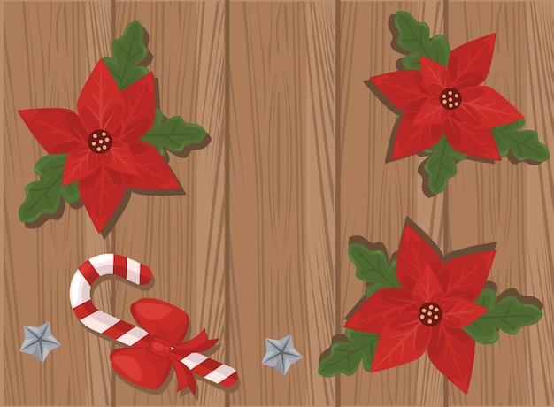 Frohe weihnachtskarte mit blumen und blättern im hölzernen hintergrund