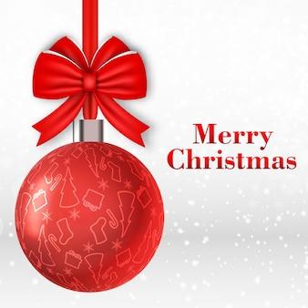 Frohe weihnachtskarte mit großer roter kugel verziert mit bogen