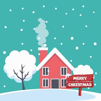 Frohe weihnachtskartenentwurf des hauses in der schneelandschaft
