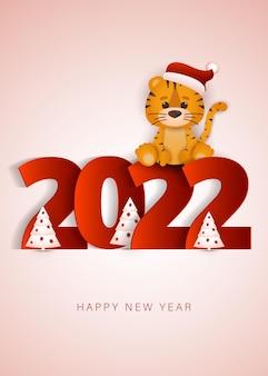 Frohes chinesisches neues jahr 2022 grußkarte kleines tigerjahr süßer tiger schmückt den weihnachtsbaum