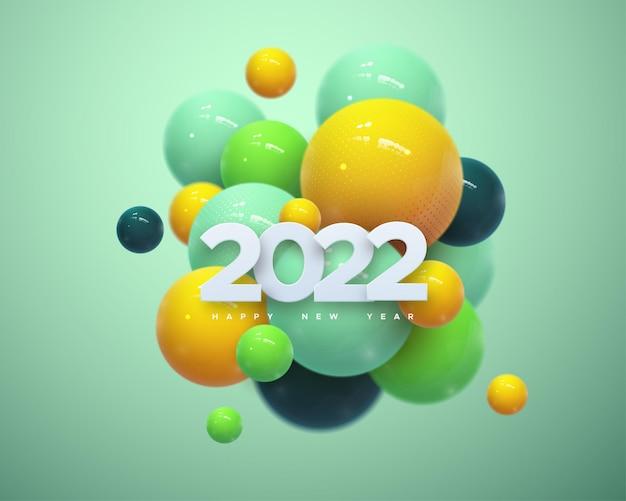 Frohes neues 2022-jahreszeichen mit weißen papierschnittzahlen und mehrfarbigen kugeln