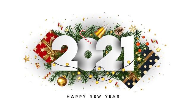 Frohes neues jahr, 2021 zahlen auf grünen tannenzweigen und feiertagsverzierungen auf weißem hintergrund. grußkarte oder werbeplakatvorlage. .