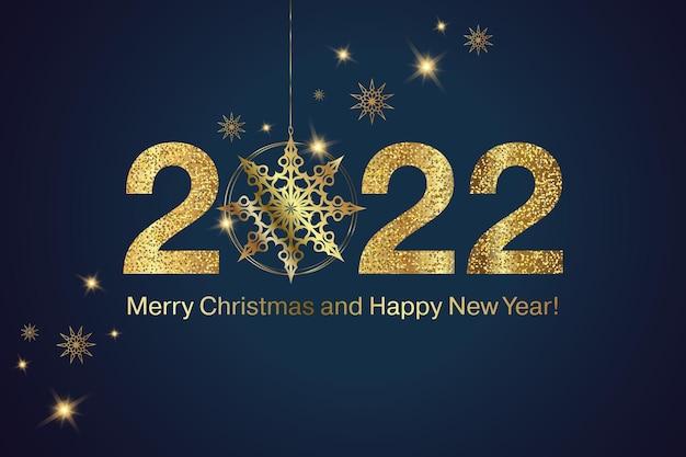 Frohes neues jahr 2022 goldene zahlen mit weihnachtsdekoration feiertagsgrußkartendesign