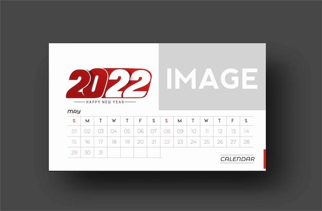 Frohes neues jahr 2022 kalender - neujahrsfeiertagsgestaltungselemente für weihnachtskarten, kalenderfahnenplakat für dekorationen, vektorillustrations-hintergrund.