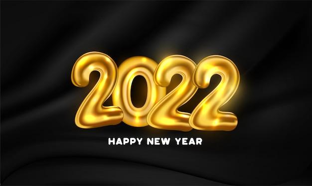 Frohes neues jahr 2022 mit goldenen ballonzahlen und schwarzem vorhanghintergrund