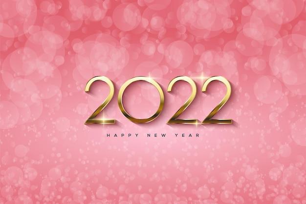Frohes neues jahr 2022 mit goldenen zahlen auf rosa bokeh-hintergrund
