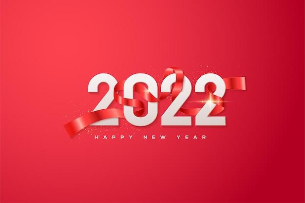 Frohes neues jahr 2022 mit weißen zahlen in rotem band gewickelt